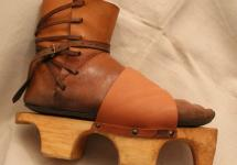 Medieval shoes to be laced up with leather straps, with wooden soles